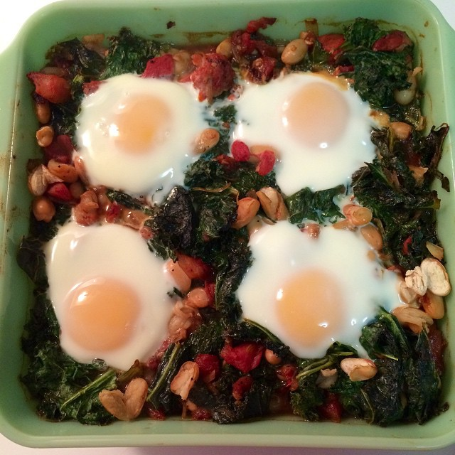 Baked eggs w balsamic kale, tomatoes, and cannellini beans #eatrealfood